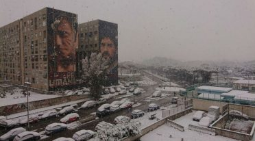 snow in naples on the mural of maradona