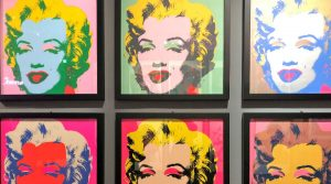 poster of Andy Warhol in Naples on display at the Basilica of Pietrasanta